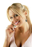 Attractive female making a phone call. Attractive blonde female making a phone call, isolated over white Stock Image