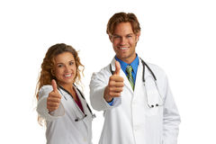 Attractive female and male doctor giving approval Stock Photography