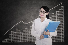 Attractive female medical student with profit bar chart Stock Image