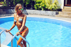 Attractive female model in bikini at the pool Stock Image