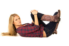 93c25d4c802 Attractive female model laying down in cowboy boot royalty free stock images