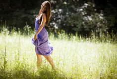 Attractive female model in purple dress. Stock Photos
