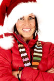 Attractive female model wearing a santa hat arms folded Stock Photos