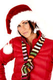 Attractive female model wearing a santa hat with serious look Royalty Free Stock Photo