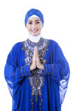 Attractive female muslim in blue dress on white Royalty Free Stock Photo