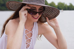 Attractive Female Peers over Sunglasses Stock Images