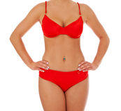 Attractive female person in red bikini Stock Photos