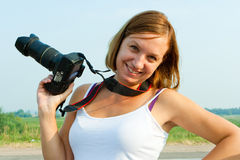 Attractive female photographer with camera Royalty Free Stock Image