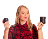 Attractive female photographer choosing lens - isolated on white Royalty Free Stock Image