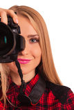 Attractive female photographer holding a professional camera - i Royalty Free Stock Photos