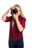 Attractive female photographer holding a professional camera - i Stock Photos