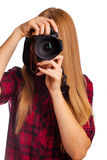 Attractive female photographer holding a professional camera - i stock images