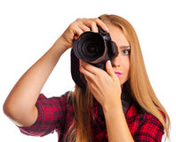 Attractive female photographer holding a professional camera - i royalty free stock images