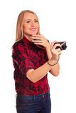 Attractive female photographer humiliating compact camera - isol Stock Photo