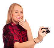 Attractive female photographer humiliating compact camera - isol Royalty Free Stock Photo