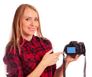 Attractive female photographer showing screen of camera  - isola Stock Images