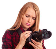 Attractive female photographer studying her professional camera Stock Photography