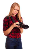 Attractive female photographer studying her professional camera Stock Photos