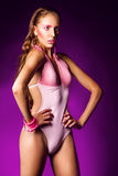 Attractive female on pink swimming suit Stock Photography