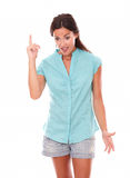 Attractive female pointing up while looking down Royalty Free Stock Photos