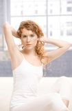 Attractive female posing in dance studio Royalty Free Stock Photography