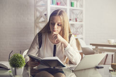 Attractive female reading book Royalty Free Stock Images