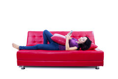 Attractive female reading e-book - isolated Stock Photos