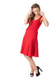 Attractive female in red dress chat over mobile Stock Photo