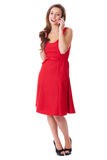 Attractive female in red dress text using mobile Royalty Free Stock Photo