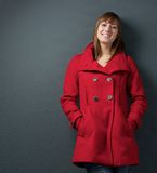 Attractive female in red winter jacket Royalty Free Stock Photo