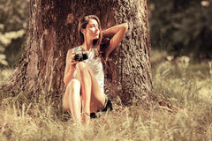 Attractive female relaxing in nature. Royalty Free Stock Photos
