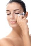 Attractive female removing eye make up Stock Photography