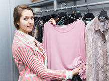 Attractive female renewing her wardrobe Stock Photography