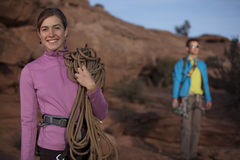Attractive Female Rock Climber Smiling Royalty Free Stock Photos