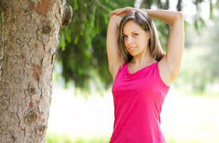 Attractive female runner stretching before her workout Stock Image