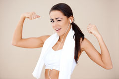 Attractive female showing her biceps Royalty Free Stock Photography