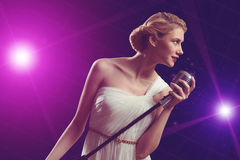 Attractive female singer with microphone Stock Photos