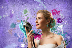 Attractive female singer with microphone Stock Photography
