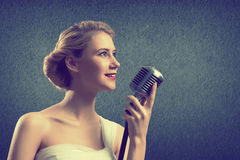 Attractive female singer with microphone Royalty Free Stock Photo