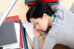Attractive female sleeping at the desk Royalty Free Stock Photo