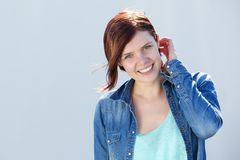 Attractive female smiling outdoors Royalty Free Stock Image