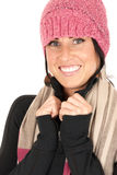 Attractive female smiling wearing pink knit hat an Stock Photo