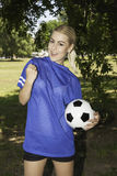 Attractive female soccer player. Portrait of attractive female soccer player stock photos