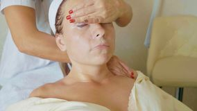 Attractive female at spa health club getting a facial procedure and massage royalty free stock photo