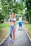 Young people exercising in city park royalty free stock photography
