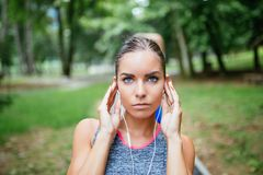Young woman exercising in city park royalty free stock photography