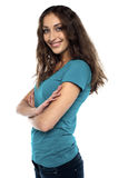 Attractive female standing sideways and smiling Royalty Free Stock Photo