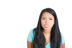 Attractive female sticking tongue out Stock Photos