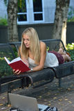 Attractive female student on campus Royalty Free Stock Images