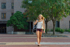 Attractive female student on campus Royalty Free Stock Photos